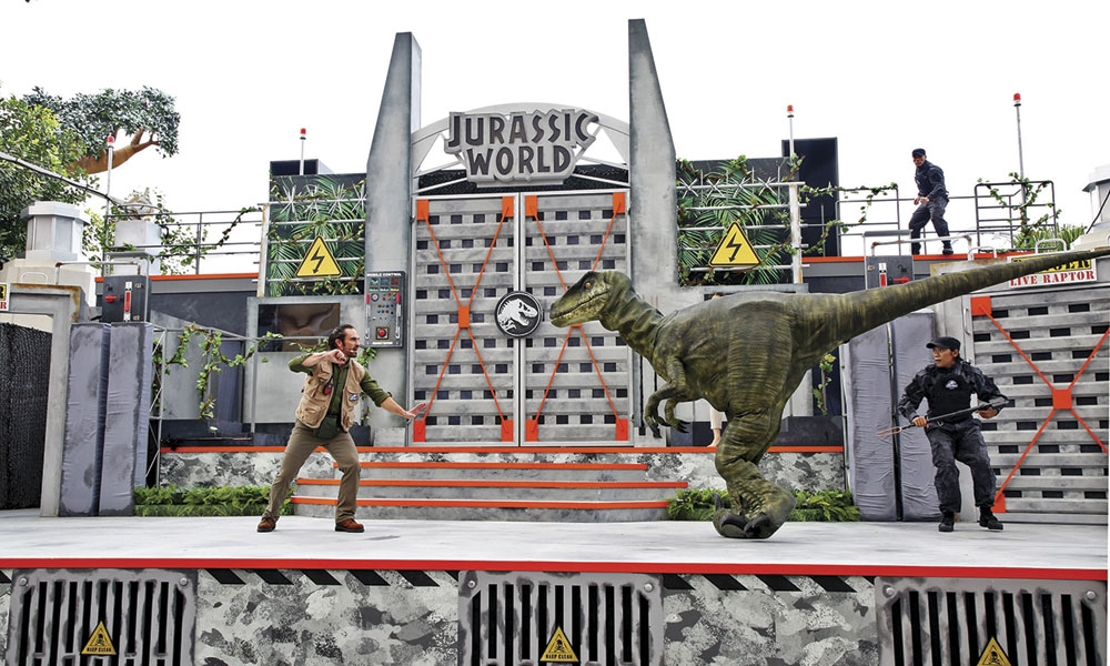 A life-sized velocirap-tor takes the stage. Soon, a giant T. rex and swooping Pteranodons will surprise the unsuspecting audience. (Contributed Photo)