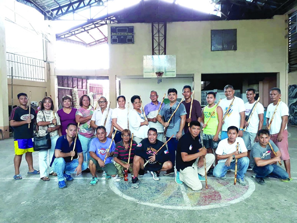 READY TO PROTECT. Aside from the grassroots project, Barangay Day-as barangay tanods also trained in arnis under Councilor Ekin Caniga, who heads the barangay's  Committees on Sports and Peace and Order. (Contributed photo)
