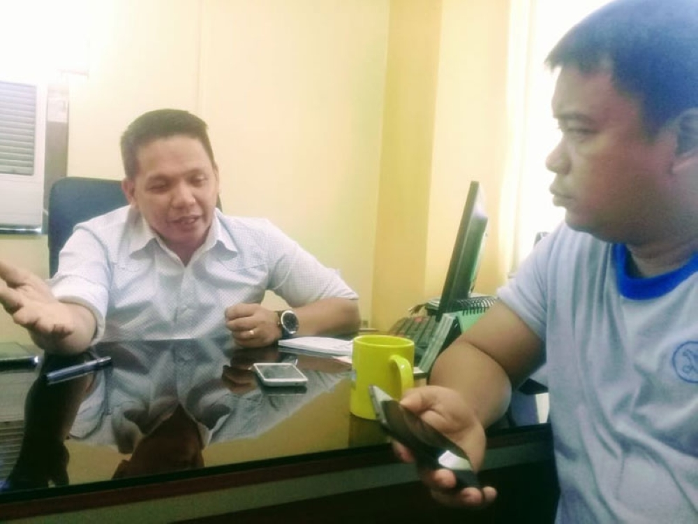 LEYTE. Edgar Tenasas, assistant schools division superintendent in Leyte, answers media inquiries over the death of Emylou Malate, a newly-hired teacher in the upland village school in LaPaz, Leyte. Malate killed herself on July 12 allegedly due to depression. (Ronald O. Reyes)