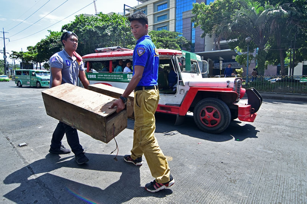 DAVAO. Personnel of the Land Transportation Office in Davao region carry the two confiscated huge speaker boxes from a Toril route jeepney yesterday during their operation along Roxas Avenue in Davao City. More or less 15 Toril jeeps were stripped off of their huge speakers after the operation. Toril jeeps are notorious for loud music and overspeeding. (Photo by Macky Lim)