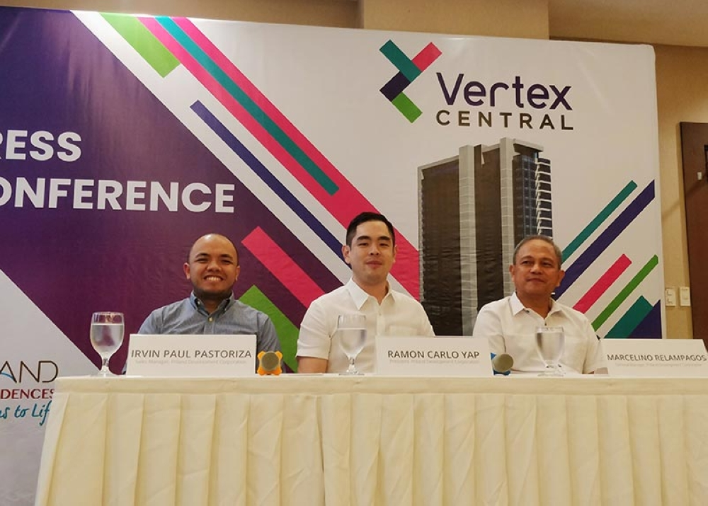 Priland Development Corp. general manager Marcelino Relampagos (right) speaks at the media launch of Vertex Central. With him are Priland president Ramon Carlo Yap (center) and sales manager Irvin Paul Pastoriza.