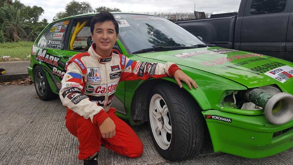 BAGUIO. Fourteen-year-old racing phenomenon Inigo Anton beside his Mark Young x Mohspeed prepared Honda EF. (Contributed photo)