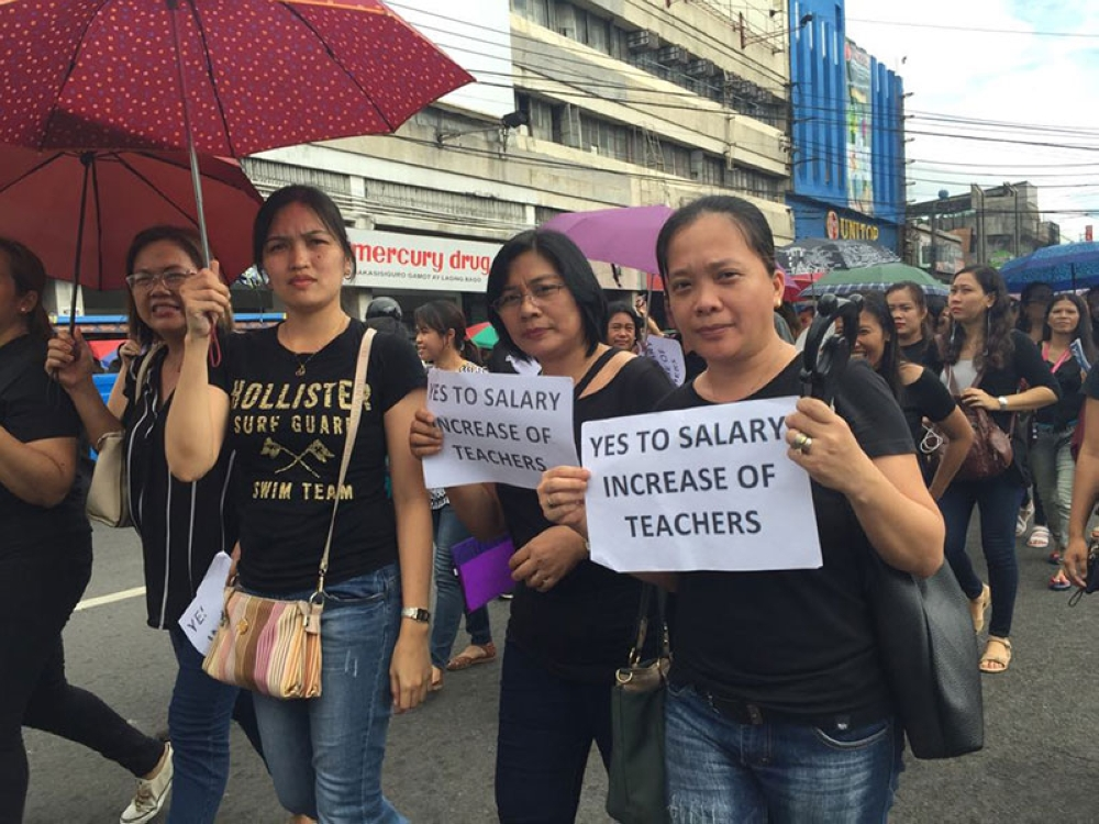 BACOLOD. Public school teachers troop to the Fountain of Justice in Bacolod City Friday to demand a salary increase and stop the tax reform law. (Merlinda A. Pedrosa)