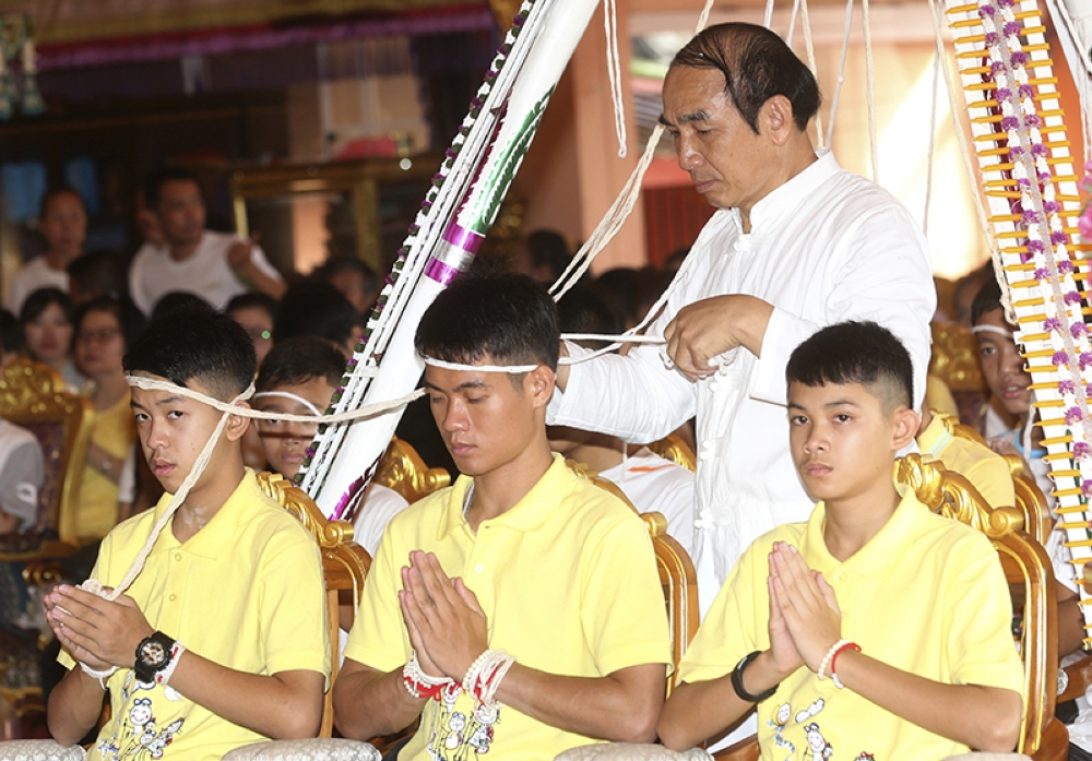 THAILAND. Soccer coach Ekkapol Janthawong, center, and members of the rescued soccer team attend a Buddhist ceremony that is believed to extend the lives of its attendees as well as ridding them of dangers and misfortunes in Mae Sai district, Chiang Rai province, northern Thailand, Thursday, July 19, 2018. (AP)