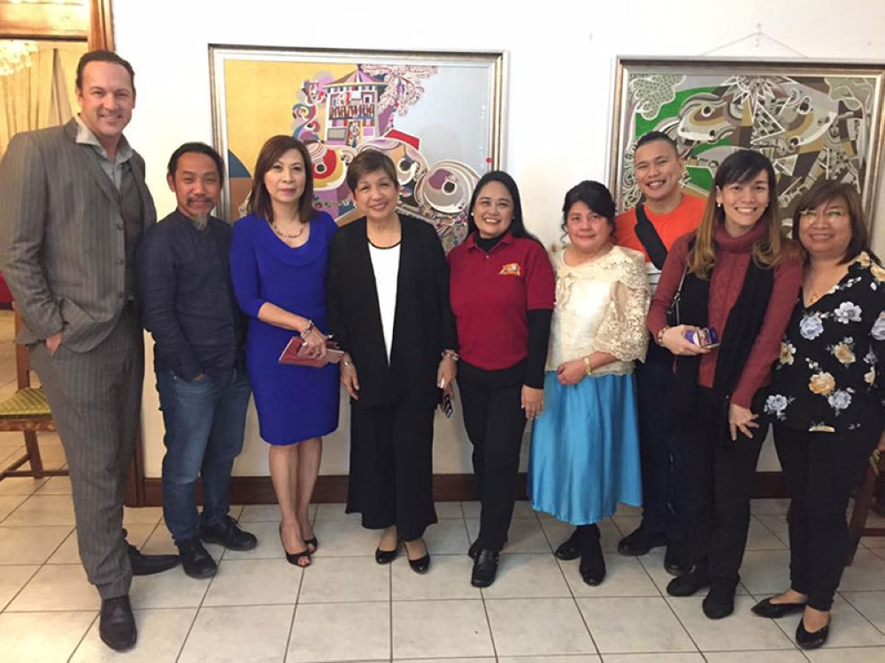 AUSTRALIA. Friends old and new. Among those who graced the exhibit were (from left) Scott Pohibun, Kublai Millan, Cecille Flores, Ambassador Mindy Cruz, Dr. Mae Dolendo, Hildegarde Palafox, Rojim Sorrosa, Cheryl Gomez, and Lilibeth Arcena. At left are some of the paintings that raised funds for children with cancer of the House of Hope Foundation. (PH Embassy)