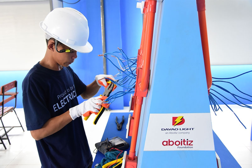 DAVAO. Darwin Jay Dael, a student taking up Electrical Installation and Maintenance (EIM) course at Vicenta Nograles National High School, shows his skills in rewiring in the newly turned over e.Lab. (Contributed photo)