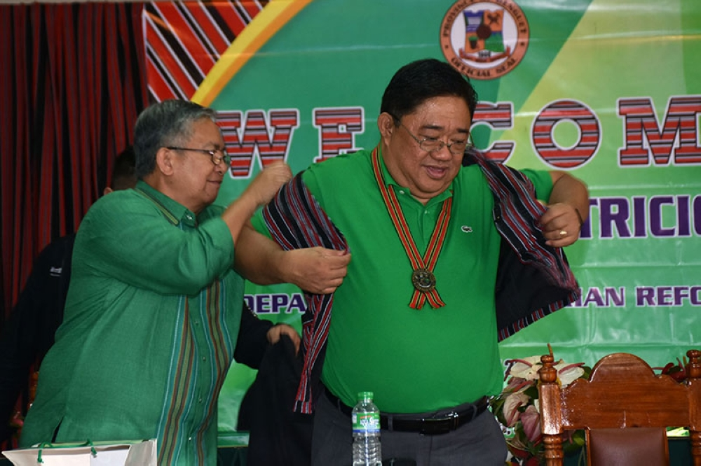 Department of Agrarian Reform (DAR) Secretary John Castriciones is garbed in a traditional Benguet inspired vest given by Governor Crescencio Pacalso during his visit to the province. (Redjie Melvic Cawis)