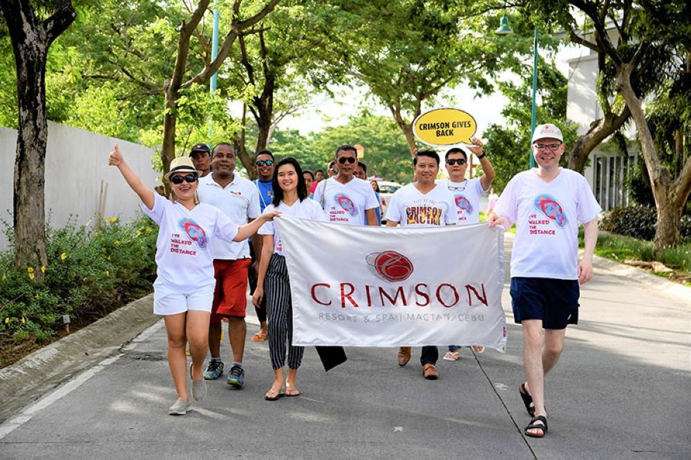 HAPPY FEET. The Crimson Resort & Spa Mactan management leads the ceremonial walk for this year's Project Happy Feet Slipper Race. (Contributed photo)