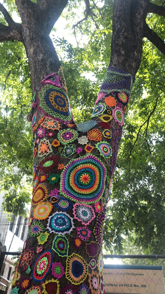 A BEAUTY BOMB. The Cebu Crochet Group said 'yarn bombing' is just like graffiti, but it's the trees you're decorating using crochet installations. (Contributed photo / USJ-R Intern Clarenz Jay Mendoza)