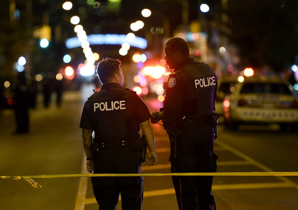 TORONTO. Police work the scene of a shooting in Toronto on Sunday, July 22, 2018. (Nathan Denette/The Canadian Press via AP)