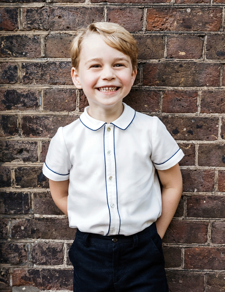 LONDON. In this photo taken on Monday, July 9, 2018, Britain's Prince George poses for a picture following the christening of his brother Prince Louis, at Clarence House in London. Britain's Prince William and Kate, Duchess of Cambridge have released a photo of Prince George to mark his fifth birthday on Sunday, July 22. (AP)