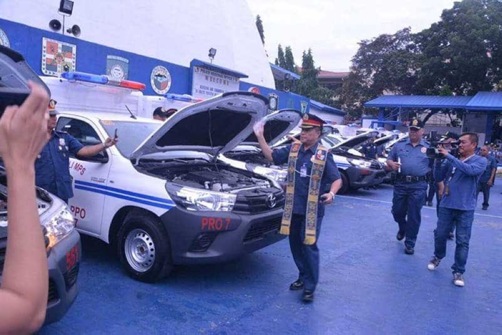CEBU. A priest blesses the 31 patrol vehicles that will be distributed to police stations in Central Visayas. (Photo by Johanna Marie O. Bajenting/SunStar Cebu)
