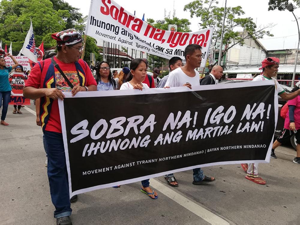 CAGAYAN DE ORO. Militants bring their own placards to protest President Rodrigo Duterte's second year in office. (Pamela Jay Orias)