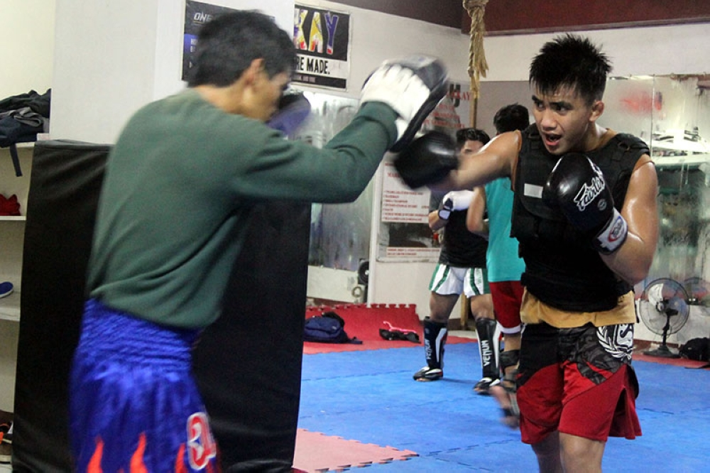 POUND IT HARD. Aside from improving his ground game, Team Lakay's Joshua Pacio is constantly working on his boxing skills. Pacio will take on Pongsiri Mitsatit in the undercard of ONE: Reign of Kings, which takes place at the 20,000-capacity SM Mall of Asia Arena in Manila, on July 27. (Roderick Osis)