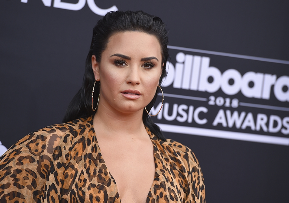 NEVADA. In this May 20, 2018 file photo, Demi Lovato arrives at the Billboard Music Awards in Las Vegas. Emergency officials confirm they transported a 25-year-old woman who lives on Demi Lovato's block to the hospital amid reports that the pop star suffered a drug overdose. (AP)