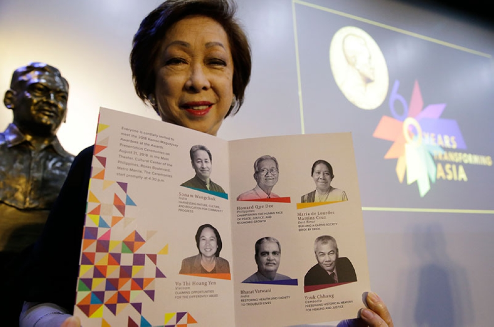 MANILA. Ramon Magsaysay Award Foundation President Carmencita Abella poses with pictures of this years' Ramon Magsaysay awardees, regarded as an Asian version of the Nobel Peace Prize, in Manila, Philippines, Thursday, July 26, 2018. (AP)