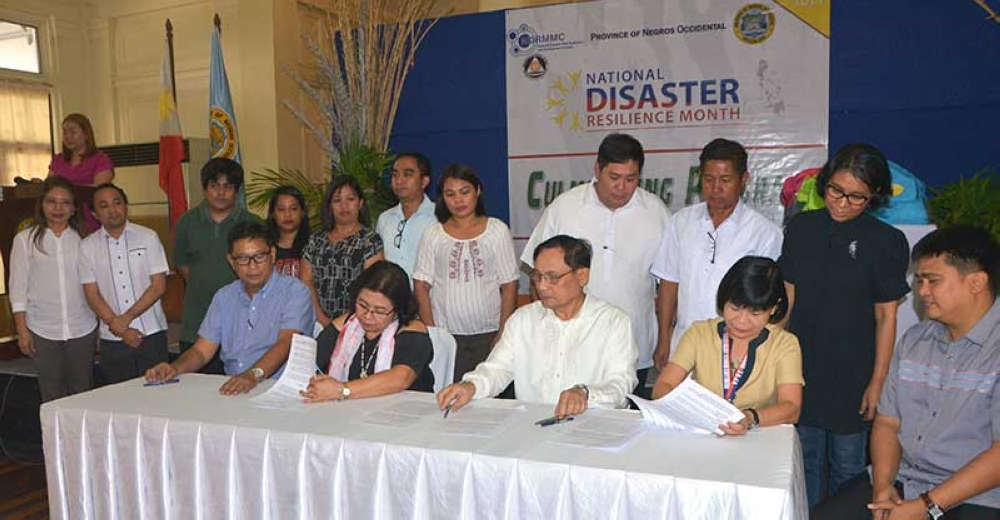 A memorandum of agreement on the Negros First Disaster Risk Reduction and Management Training Workshop on Geographic Information System and Remote Sensing of the Environment between the Provincial Government and Carlos Carlos Hilado Memorial State College was signed between the provincial government represented by Board Member Samson Mirhan (seated, left), Provincial Planning Development Officer Ma. Lina Sanogal (seated, second from left), and Provincial Disaster Management Program head Zeaphard Caelian (seated, right), and Carlos Hilado Memorial State College led by president Renato Sorolla (seated, center) and vice president for Research and Extension Janet Espinosa. (Contributed Photo)