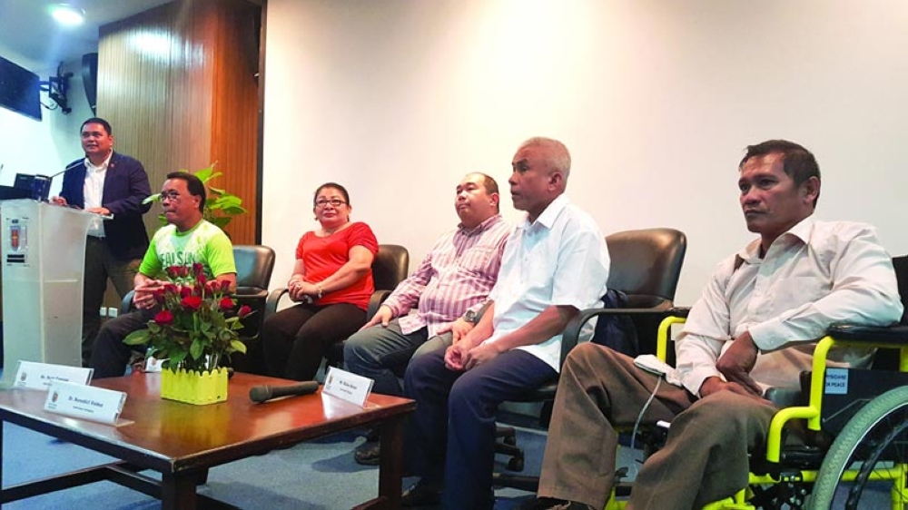 ALL DESERVING. Five finalists in the RAFI Triennial Awards individual category were presented yesterday in the Eduardo Aboitiz Development Studies Center. They are (seated, from left) Dr. Roel Cagape, Sarah Pasion Cubar, Dr. Benedict Valdez, Mateo Quilas, and Norlan Pagal. Anton Dignadice (at lectern) of RAFI moderates the discussion. (SunStar photo / Ruel Rosello)