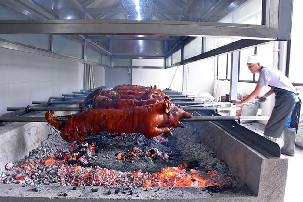 MANILA. Rico's Lechon roasting pit at The Fort, BGC. (Juan Miguel D. Bonjoc)