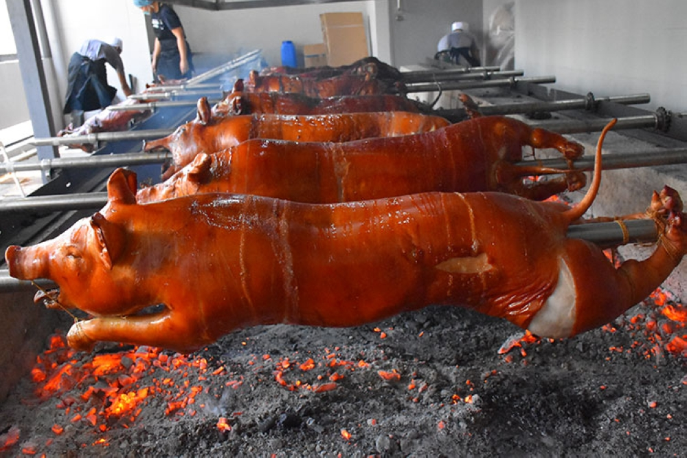 MANILA. Rico's Lechon at the roasting pit at The Fort, BGC. (Juan Miguel D. Bonjoc)