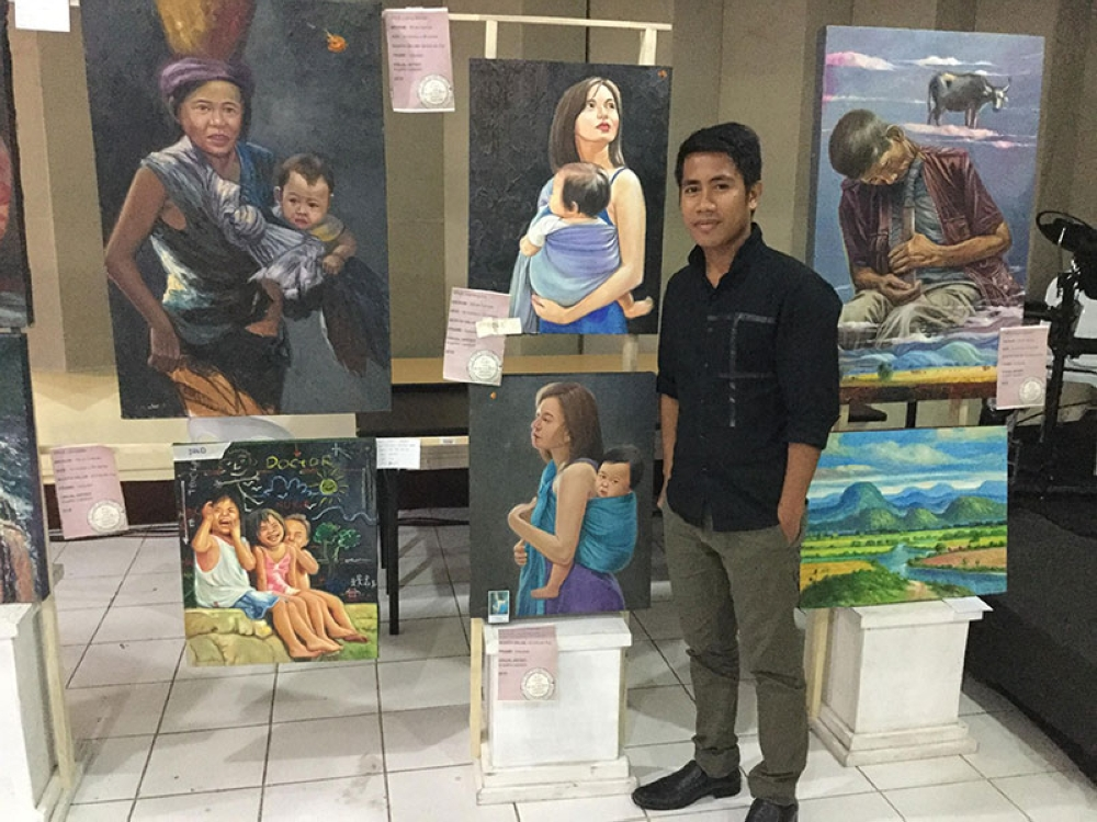 BACOLOD. The artists and their masterpiece. (Contributed Photo)