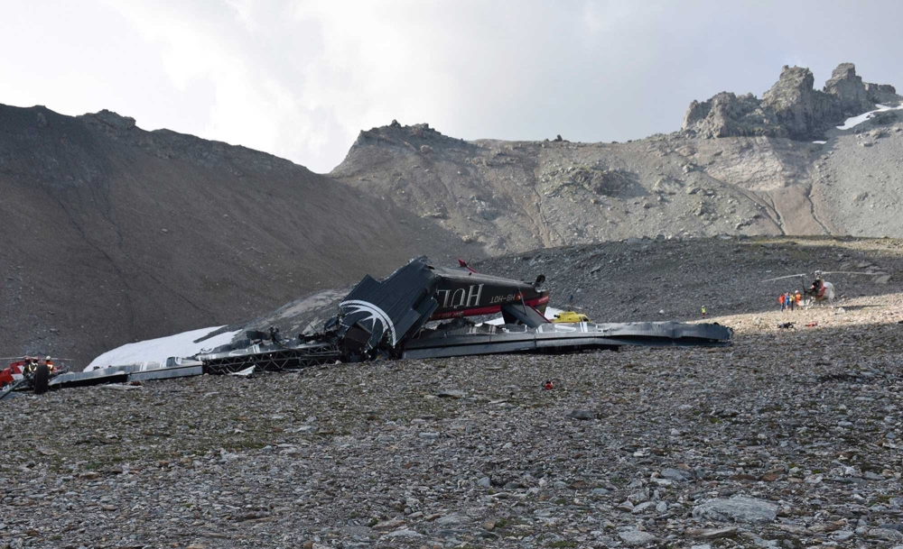 SWITZERLAND. The photo provided by Police Graubuenden shows the wreckage of the old-time propeller plane Ju 52 after it went down went down Saturday Aug, 4 2018 on the Piz Segnas mountain above the Swiss Alpine resort of Flims, striking the mountain's western flank about 2,540 meters (8,330 feet) above sea level. All 20 people on board were killed, police said Sunday, Aug. 5, 2018. (AP)