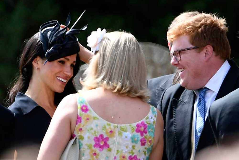 ENGLAND. Meghan, Duchess of Sussex arrives to attend the wedding of Charlie van Straubenzee and Daisy Jenks at St Mary the Virgin Church in Frensham, England, Saturday, Aug. 4, 2018. (PA via AP)