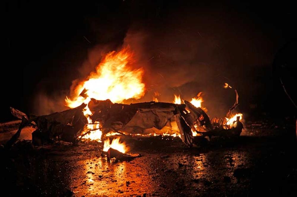 SOMALIA. Cars burn after one of two car bombs, in Mogadishu, Somalia, Sunday Aug. 5, 2018. Two car bombs hit Somalia on Sunday, killing at least six people. (AP)