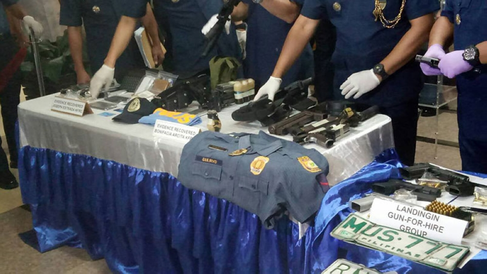 MANILA. Police present a police uniform with the name Siervo and other evidence recovered from an alleged safe house where a kidnapping victim was kept in Laguna. (Photo contributed by PNP-AKG)