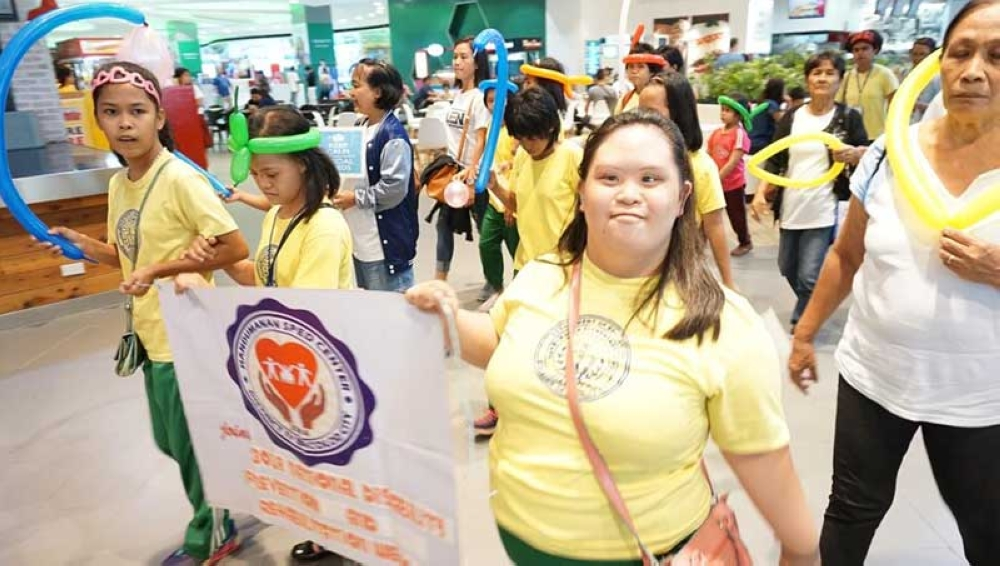 """BACOLOD. About 130 PWDs in Bacolod and organizers participate in the """"Angel Walk"""" at SM City Bacolod Thursday, August 2, to mark the annual 40thNational Disability Prevention and Rehabilitation Week. (Contributed Photo)"""