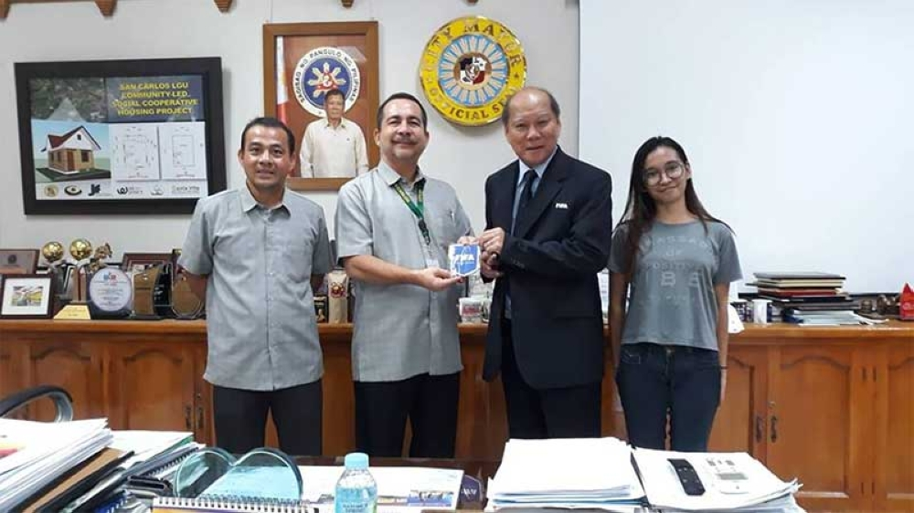 Fifa instructor Nyim Keong Yap and assistant PFF/Fifa instructor Lyn Antonio pay a courtesy visit to San Carlos City Mayor Gerardo Valmayor (secondfrom left). Also in photo is PFF Regional Technical Director for Visayas John Carmona (left).  (Contributed Photo)