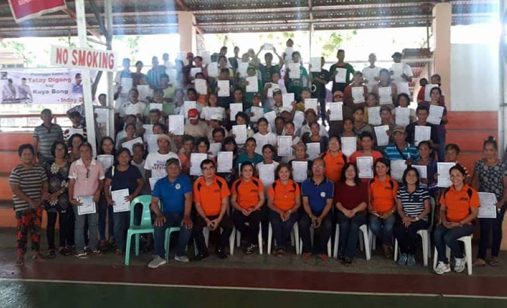 BACOLOD. DAR-Negros Occidental South officials and personnel led by Provincial Agrarian Reform Program Officer II Lucrecia Taberna (seated, 4th from right) with the farmer-beneficiaries during the distribution of land titles at Isabela Gymnasium on August 9, 2018. (Contributed photo)