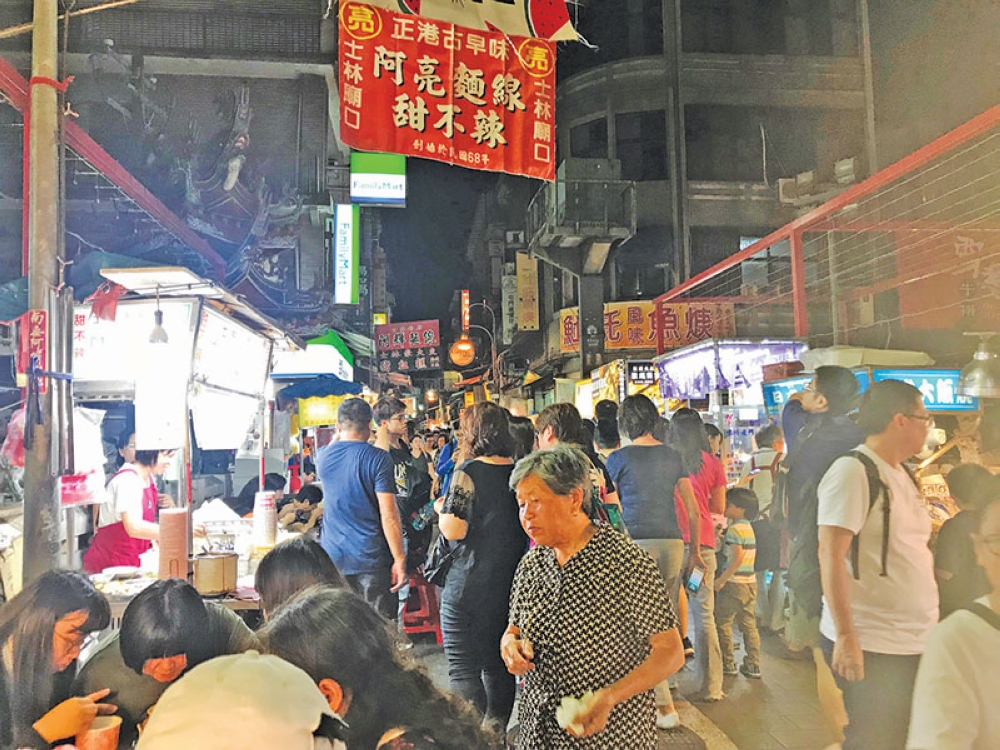 "TAIWAN. A section of what my sister and I think is part of the Shilin Night Market. This is where ""spicy"" is actually ""this-will-burn-a-hole-in-your-mouth"" spicy. Also: choices, you will be pleasantly assaulted by food choices. (Christine Salazar)"