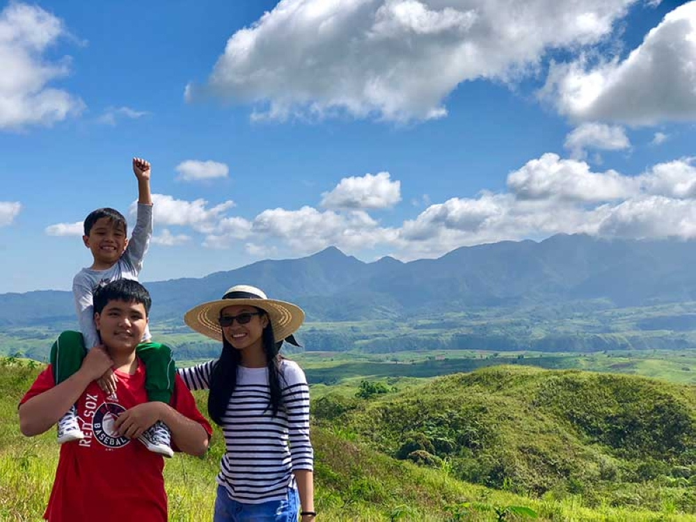 BUKIDNON. With my three most precious gems exploring the bukid. Mt Kitanglad is our backdrop. (Hannah Victoria Wabe)
