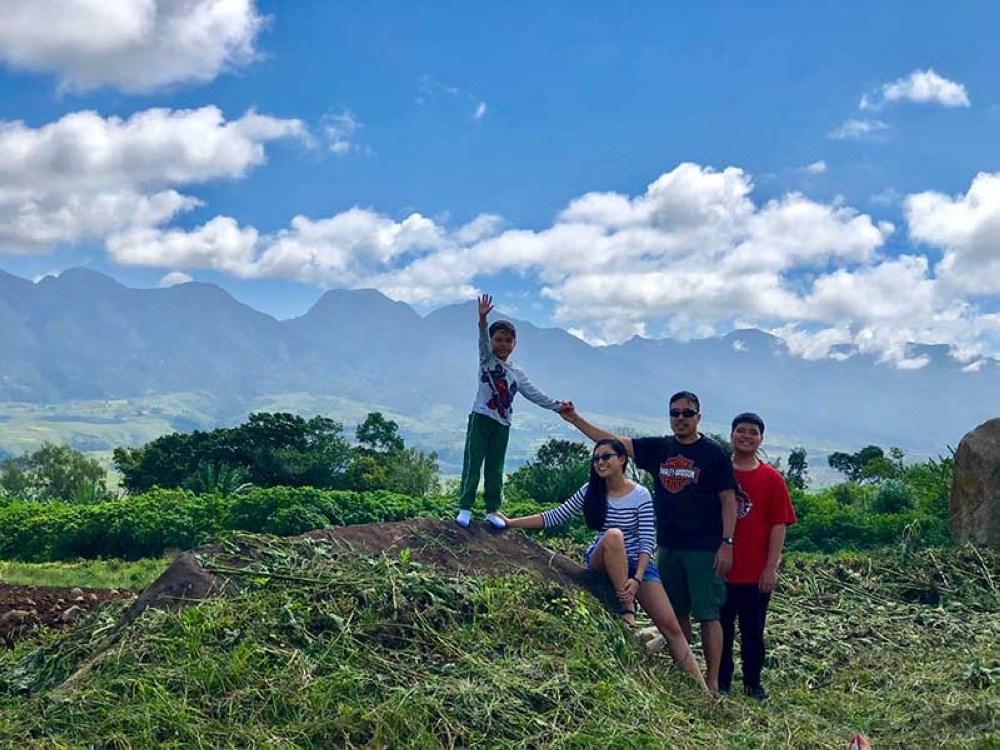 BUKIDNON. Taking the scenic route to Lantapan with the beautiful Kitanglad Mountain Range as our backdrop. These are my most favorite people in the world. Photo taken by mom, of course.