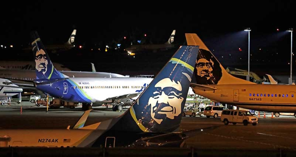 Alaska Airlines planes sit on the tarmac at Sea-Tac International Airport Friday evening, Aug. 10, 2018, in SeaTac, Wash. An airline mechanic stole an Alaska Airlines plane without any passengers and took off from Sea-Tac International Airport in Washington state on Friday night before crashing near Ketron Island, officials said. (AP)