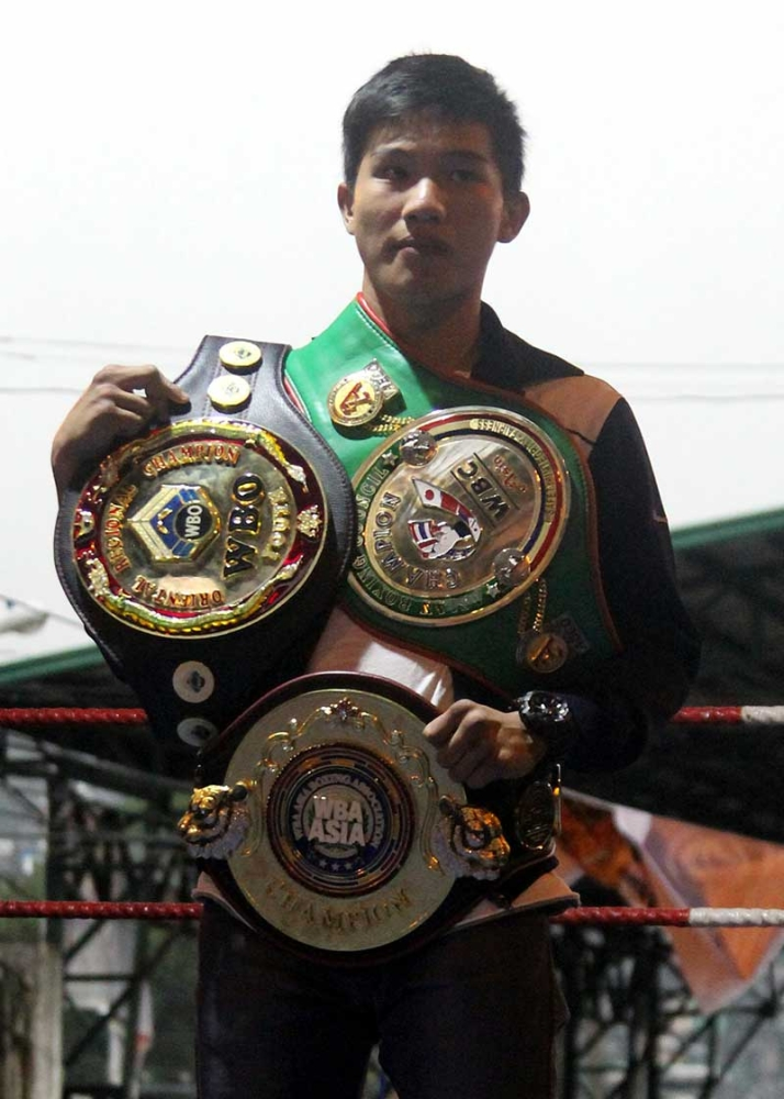 BAGUIO. Ifugao boxing whiz kid Carl Jammes Martin retains his World Boxing Organization Oriental Youth Bantamweight title after stopping Huerban Qiatehe. (SunStar Baguio photo)