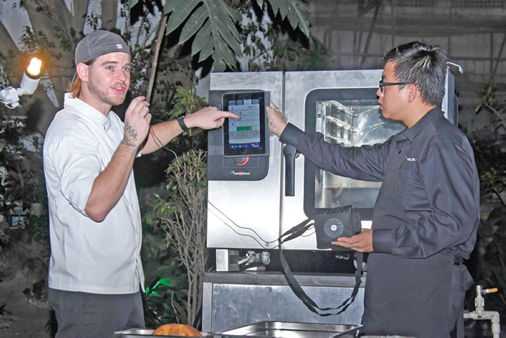 DAVAO. French chef, Chef Matt, demonstrates how the oven is convenient in the kitchen especially if its modern feature, which allows it to be operated via an app, is installed in a device. (Contributed Photo)