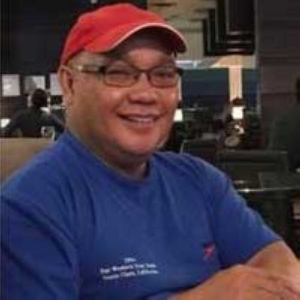 Wilfred Arzaga, a veteran swimming coach from Canada (Contributed Photo)