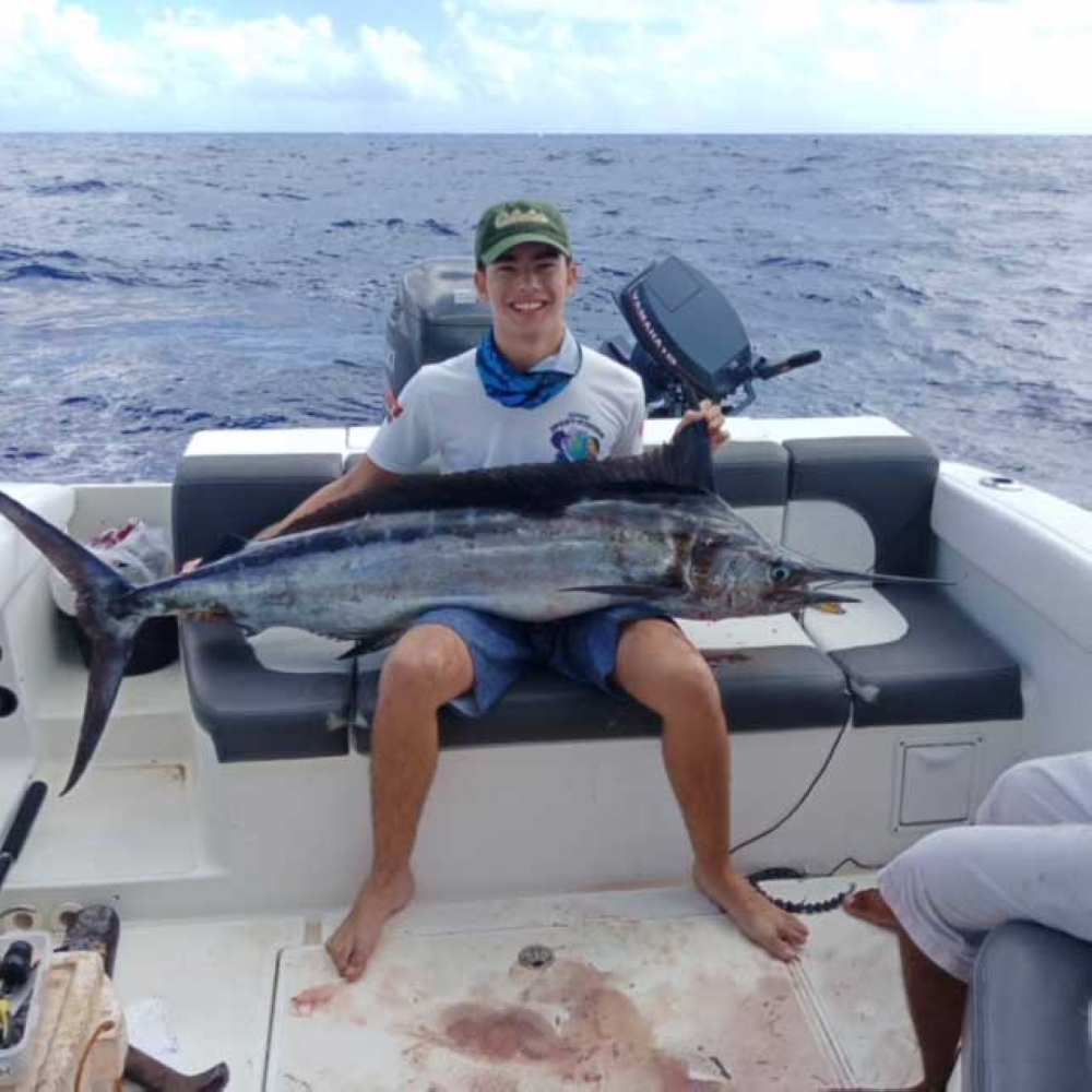 Paulie shows the 31-kilo blue marlin he caught. (Marchel P. Espina)