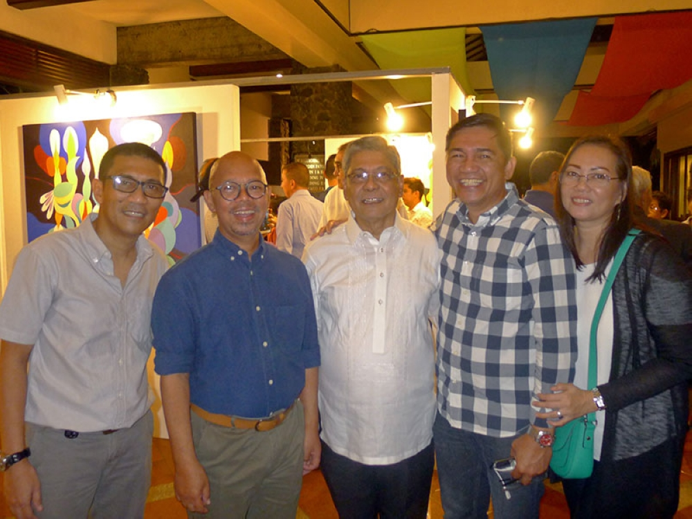 The featured artist, his peers & book publisher - Brando Ceden~o, Vic Secuya, Nandie Subido, Alex Alagon & Sabel Alagon. (Contributed photo)