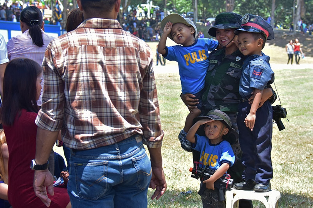 CONGRATS TITA! A Police officer who just graduated from the Basic Internal Security Operation Course on Monday, August 13, 2018 at the Police Regional Office-Davao receive a warm welcome from her three nephews as they dress up as police officers as a sign of support to their aunt. (Macky Lim)