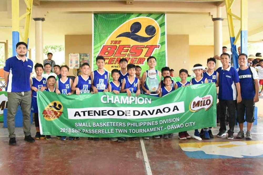 VICTORY POSE. Members of the Ateneo de Davao University Blue Knights pose after winning the Best Center SBP-Passarelle Twin Tournament 2018 small basketeers Philippines division championship title at the New Lanzona covered court in Matina, Davao City over the weekend. (Jai Gracia)