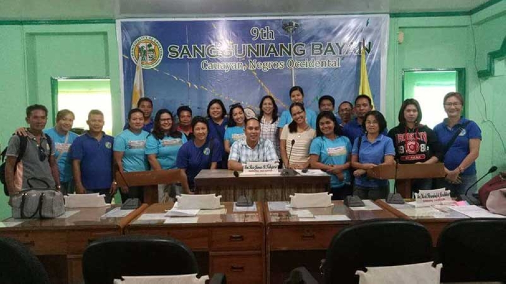 BACOLOD. Information officer Leah Novero (standing, 10th from left) and other PVO personnel pay courtesy call to local government officials of Cauayan led by Vice Mayor Rico James Tabujara (seated) as part of the cross visit initiative for district field units at the said town yesterday. (Contributed Photo)