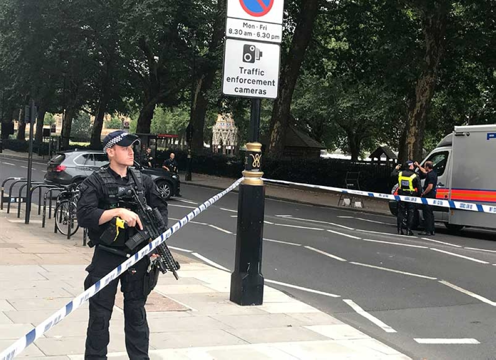 LONDON. Police patrol on Millbank, in central London, after a car crashed into security barriers outside the Houses of Parliament, in London, Tuesday, Aug. 14, 2018. (AP)