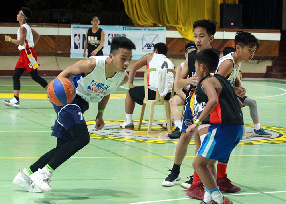 BAGUIO. Young ballers compete during the off NBA 3X Philippines 2018 presented by AXA with the first-ever qualifiers in North Luzon at Benguet State University on Aug. 11-12. (Photo by Jean Cortes)