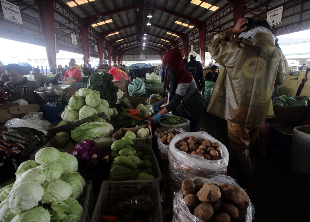 BAGUIO. Despite the recent rains brought about by the southwest monsoon, the supply of vegetables at the La Trinidad vegetable Trading Post remains stable albeit prices have increased. (Photo by Jean Cortes)