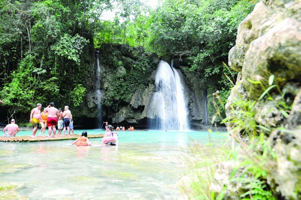 HIGHLIGHT. Delegates of the Suroy-Suroy Sugbo Southern Getaway cool off in the Kawasan Falls in Badian. The southwestern town was one of those named in a UK travel advisory that warned its residents against travel to the Philippines due to terrorism threats. (Sunstar file)
