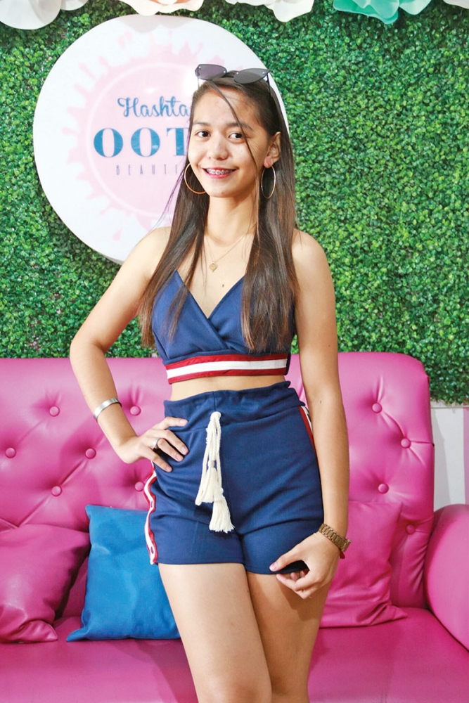 DAVAO. Going to a party tonight? Kadayawan will definitely be filled with a bash left and right and this two-piece smooth navy blue short and sexy top will make you stand out among the crowd. Add a pair of big round earrings and you're good to go. (Contributed Photo)
