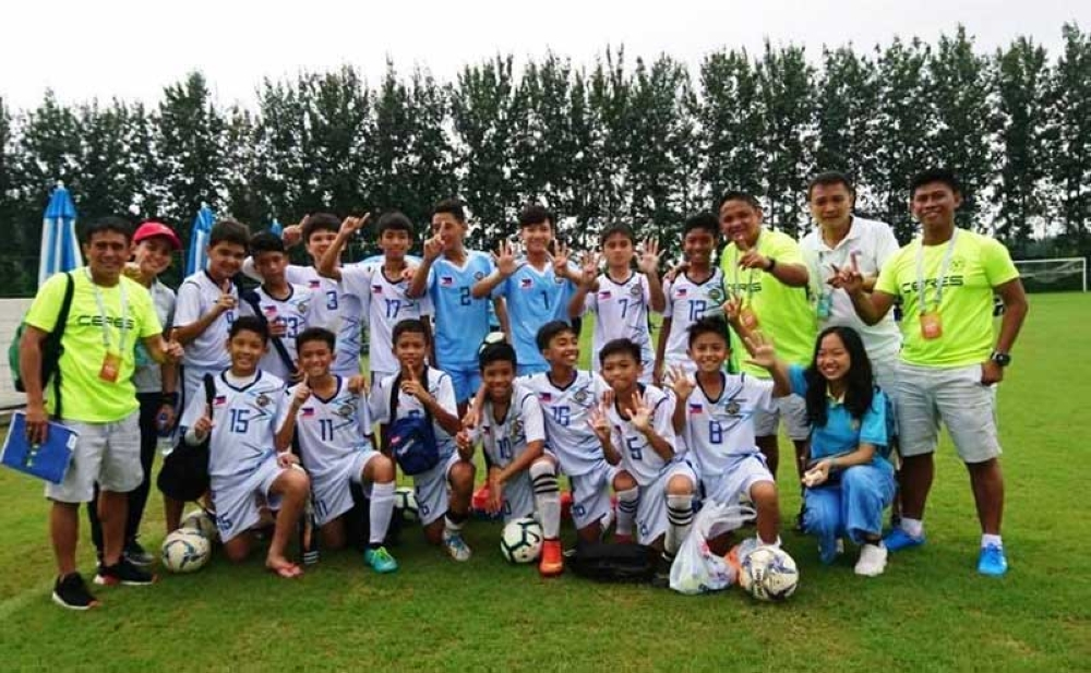 NOFA-led Philippine team poses after a huge 9-0 victory over Cambodia. (Andrew Infante)